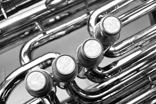 Fragment of a bass tuba valves closeup in black and white - 260469874