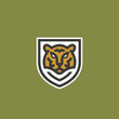 Minimalist Line Style Tiger Face Shield Abstract Vector Icon, Symbol or Logo Template. Wild Animal Head Sillhouette Incorporated in a Shield Frame with Typography. Creative Predator Emblem.