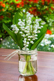 Lily of the valley and flower vase