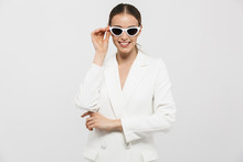 "Постер, картина, фотообои ""Beautiful happy woman posing isolated over white wall background wearing sunglasses."""