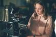 Girl cameraman behind camera on set