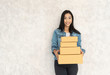 Quadro happy asian young delivery woman standing with parcel post box on white background.