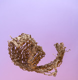 An abstract figure from a chopped corrugated cardboard on a gradient lilac-pink background.