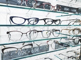 shelf with glasses in eyewear store