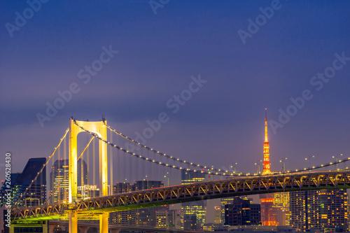 Tokyo tower with rainbow bridge sunset