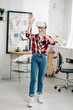 Quadro Full length view of teenager in red checkered shirt and vr headset gesturing at home