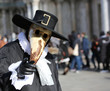 Venetian mask called Plague doctor with black hat