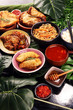 Assorted Chinese food set. Chinese noodles, fried rice, peking duck, dim sum, spring rolls. Famous Chinese cuisine dishes on table. Chinese restaurant
