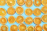 Dried orange fruits on blue background
