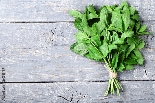 Mint leafs on grey wooden table © 5second
