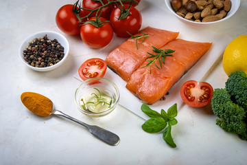 Fresh salmon with herbs, spices, vegetables, nuts. Healthy food, balanced diet concept.