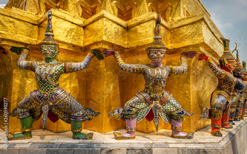 Fototapeten Bangkok Giants supporting the structure of the Golden Chedi in the Royal Palace in Bangkok