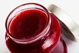 Closeup of raspberry jam in glass jar