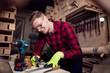 Male carpenter working hard in his workshop