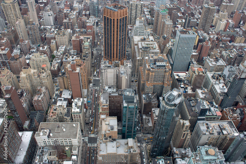 Aerial view of Manhattan in New York City showing the classic high rise buildings and city scape in the USA © Duncan