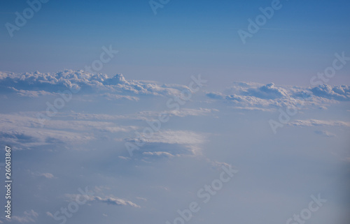 View from the airplane to the sky . Blue sky with clouds - 260613867
