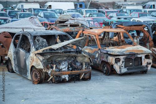 fototapeta na ścianę An abandoned, stolen burnt out car