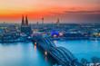 Leinwandbild Motiv Cologne Cathedral and Hohenzollern Bridge at night, Germany