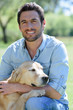 canvas print picture - handsome man with dog