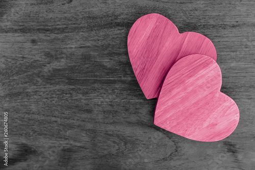 couple wood hearts pink love on wooden table with space for text © Korn V.