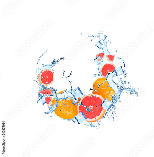 Water splash with grapefruits isolated on white background.  - 260675086