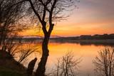 Amazing sunset over Vistula river in Torun, Poland