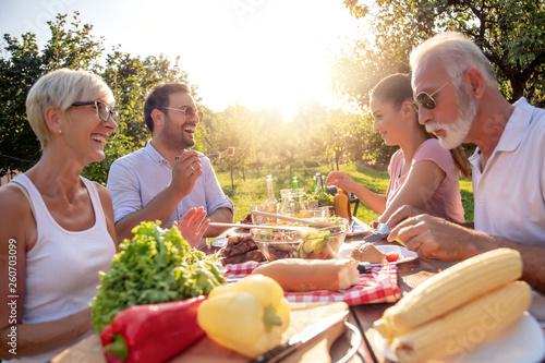 Leinwandbild Motiv Family have lunch at summer party