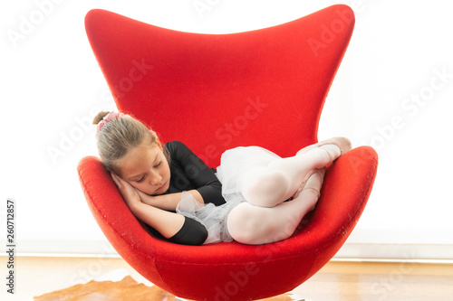 ballet dancer sleeping on red armchair © Vicen
