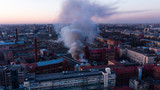 Fire in the building, black smoke rises, aerial view