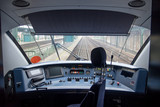 Empty train cabin of driver. Interior of control place of train standing on railway station. Cockpit modern train.