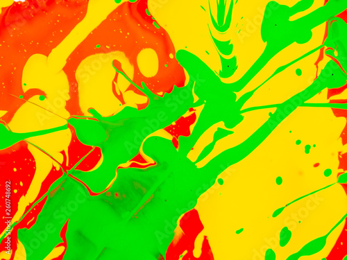 Leinwandbild Motiv splashes of red and yellow green paint on a white background
