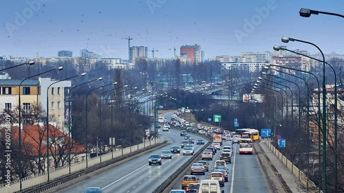 4K Timelapse: a Panoramic view of viaduct Lazienkowska Route, connecting left and right Vistula's banks of Warsaw; on the back are visible new sleeping areas of Warsaw