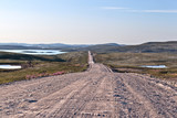 The dirt road in the tundra in northern Russia