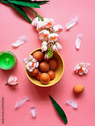 Eggs Red Grapefruits  protein vitamin Pink white apple flowers  green aroma  candle yellow plate on pink background Healthy  food vegan natural juicy red  colorful  still life  Happy Easter   - 260763006