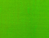 Textured background of green natural textile