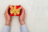 Man holding a present in hands