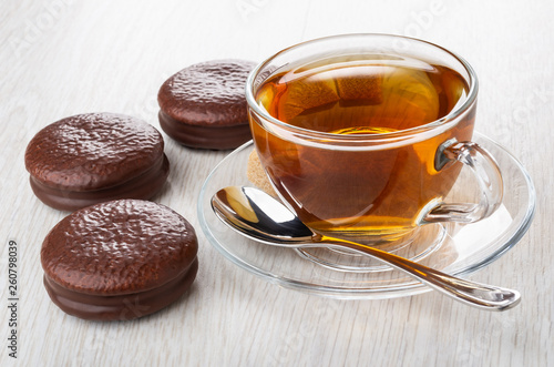 fototapeta na ścianę Chocolate cookies, cup of tea, spoon on saucer on table