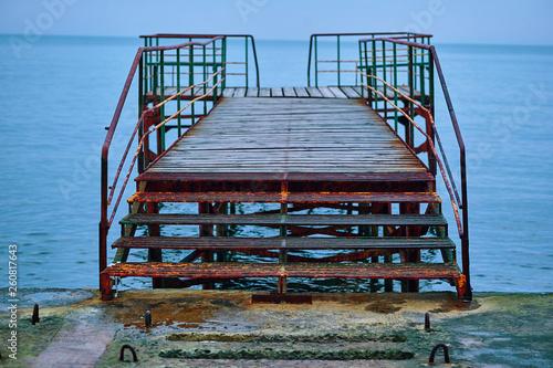 Acrylglas Pier stairs to the sea
