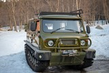 Dombay, Karachay-Cherkess Republic, Russia, 08/04/2019, UAZ SUV converted to a snowmobile tracked all-terrain vehicle