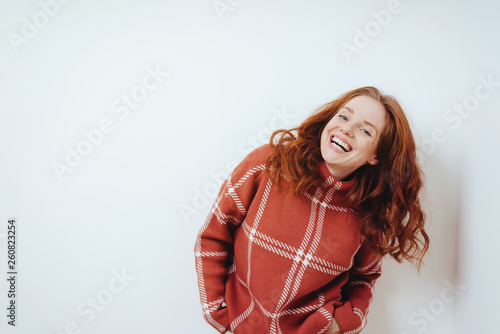 Happy cheerful young woman in a red sweater © contrastwerkstatt
