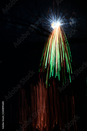 Fireworks, and light in the darkness, the abstract background - 260895685