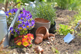 flowerpots and seeds with shovel planting in the soil in a garden in spring