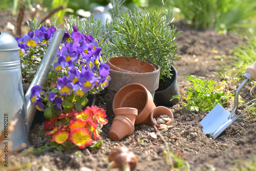 flowerpots and seeds with shovel planting in the soil in a garden in spring - 260921228