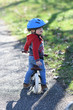 canvas print picture - child on a bike with a helmet