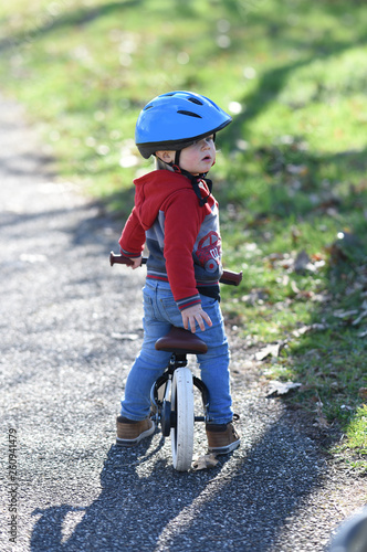 canvas print picture child on a bike with a helmet
