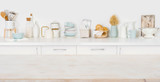 Empty wooden board with copyspace on defocused kitchen counter background