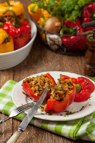 Colorful baked with cheese, stuffed peppers with rice and minced meat. - 260952296