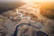 Bright sunrise over wild curved river aerial view