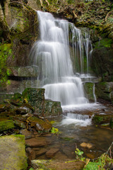 Harmby waterfall in woodland.
