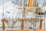 Various rigging of a sailing vessel. Marine ropes on the old ship for your concept of marine voyage under sails. Nautical equipment on ancient sailing vessel.